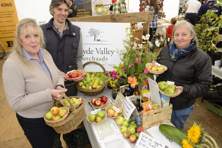 The sixth annual Fruit Day took place at Overton Farm on Saturday 03 October 2015 in Crossford, South Lanarkshire. On the Clyde Valley Orchard stand Sandra Gunn, Torsten Stein and Cheryl Osborn display their wares. ©South Lanarkshire Council