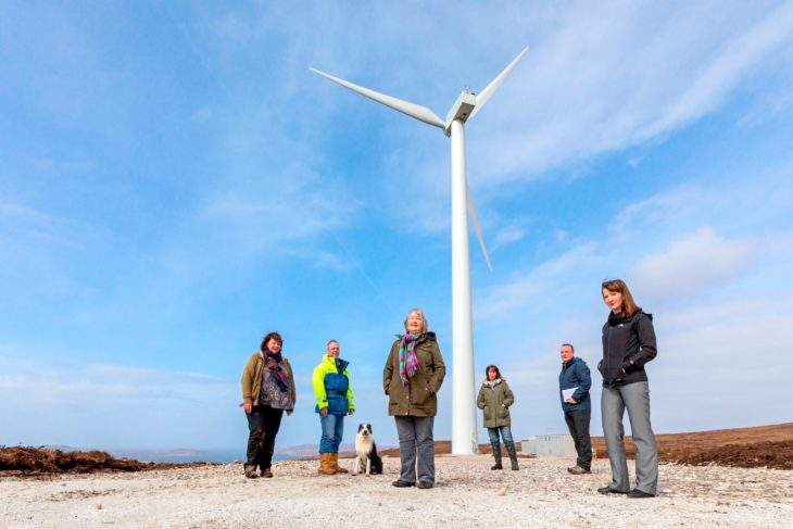Members of Coigach Community Development Company at the opening of the community wind turbine.