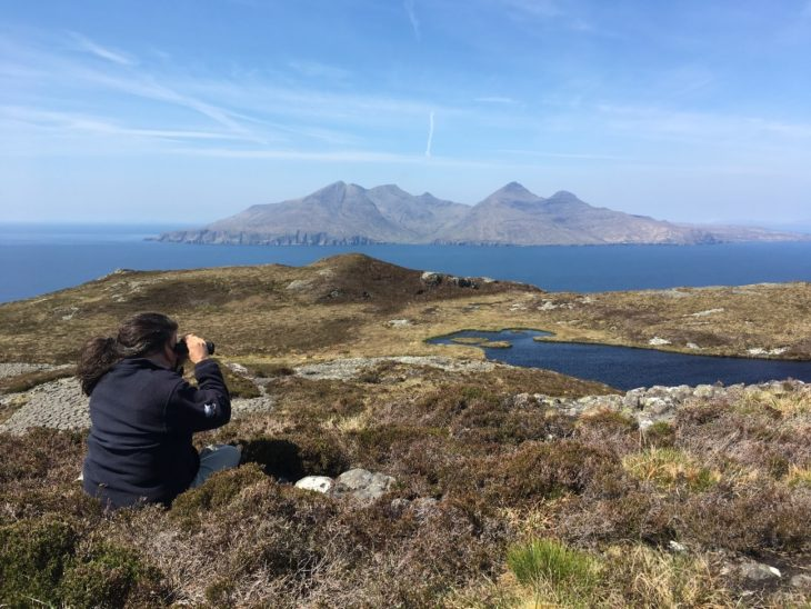 Scottish Wildlife Trust Ranger Norah Barnes during a monitoring day on the Isle of Eigg. The Isle of Rhum is in the background. © Érika Faggiani