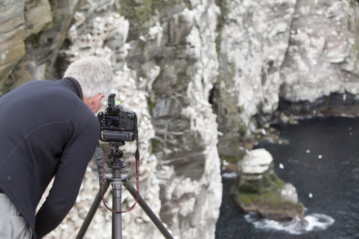 Photographer watching gannet colony © Peter Cairns, 2020VISION