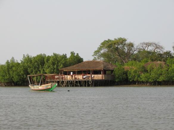 Waterside lodge on the Bintang Bolon (Credit: Sebastian Reinelt)
